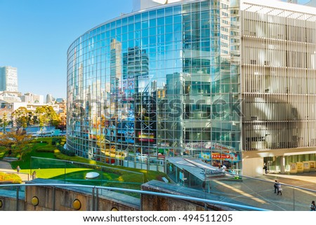 TOKYO, JAPAN - NOVEMBER 28 2015: T.V. Asahi building situated on the opposite side of Mori tower building in Roppongi Hills