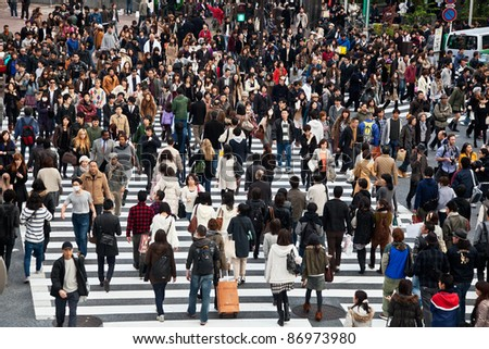 TOKYO, JAPAN - NOVEMBER 20: Unidentified pedestrians at Shibuya crossing on November 20, 2010 in Tokyo, Japan. The famous scramble crosswalk is used by over 2.5 million people daily. - stock photo