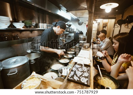 Tokyo, Japan, October 2017: Traditional street-food restaurant in Tokyo with noodles and Ramen food serving