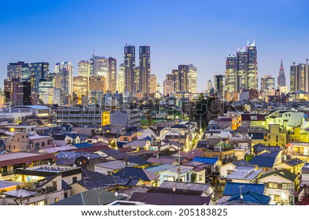 Tokyo, Japan office buildings tower over residential districts in Shinjuku Ward. - stock photo