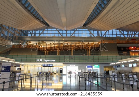 TOKYO, JAPAN - SEPTEMBER 08, 2014: A photo of Tokyo International Airport Haneda. Tokyo International Airport Haneda has become the first Japanese airport awarded 5-star status by Skytrax of the UK. - stock photo