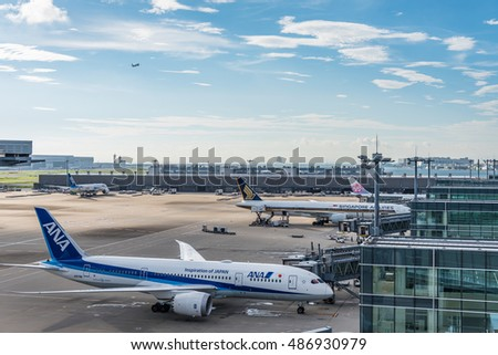 TOKYO, Japan - September, 2016: Airplane parking at Haneda Airport. Haneda or Tokyo International Airport is one of the two primary airports that serve the Greater Tokyo Area.