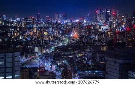 TOKYO , JAPAN - SEPTEMBER 9: Ikebukuro cityscape at night on September 9, 2013. Ikebukuro is one of Tokyo's major nightlife and fashion centers. - stock photo