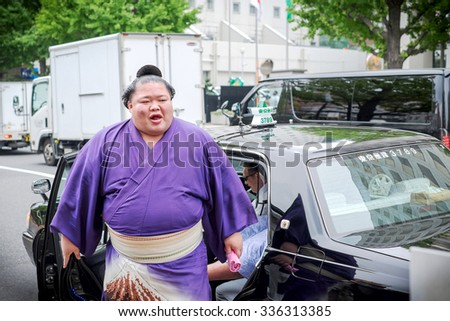 Tokyo, Japan - September 24: sumo wrestler Fujiazuma Kazuyoshi going out from taxi on September, 2015 in Tokyo, Japan. Sumo is Japan's national sport, most professional wrestlers are foreigners - stock photo