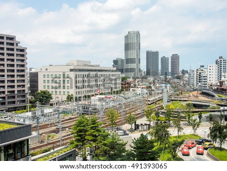 Tokyo -JUL 19: Landscape of skyscraper in Tokyo with train station on July 19, 2016.  Rail transport services in Japan are provided by more than 100 private companies