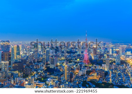 TOKYO - JUL 12: Tokyo Cityscape at twilight on Jul 12, 2014 in Tokyo. Tokyo is the capital of Japan, the center of the Greater Tokyo Area, and the most populous metropolitan area in the world. - stock photo