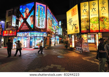 TOKYO - JULY 4: Kabukicho is an entertainment and red-light district July 4, 2011 in Tokyo, Japan. Named after an unbuilt kabuki theater, it hosts thousands of nightclubs and hostess bars. - stock photo