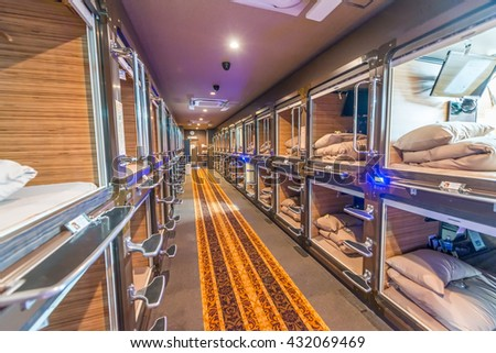 TOKYO - JUNE 1, 2016: Interior of capsule hotel in city center. Capsule Hotels are less expensive structures very famous in Tokyo. - stock photo