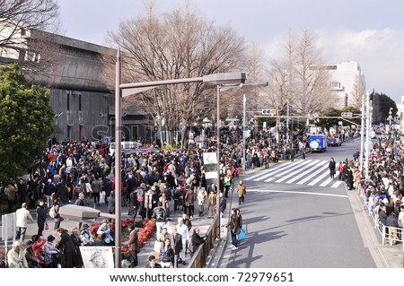 TOKYO - MAR 11: outside Ueno Station. People have rushed out of the buildings after the earthquake of March 11, 2011 in Tokyo, Japan to be safe. - stock photo
