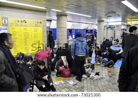 TOKYO - MAR 11: People spending the night in the subway on March 11, 2011 in Tokyo, Japan. Millions of people can't get home as all trains and subway trains have stopped because of the earthquake. - stock photo