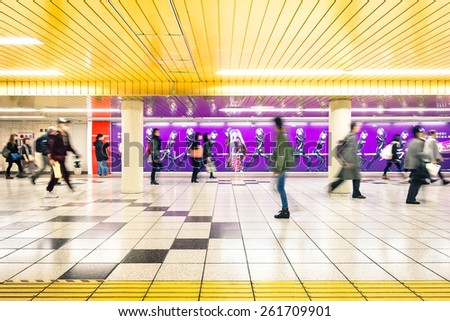 TOKYO - MARCH 2, 2015: Corridor at underground area in Shinjuku. The combined subway network of the Tokyo and Toei metros counts 290 stations and 13 lines with over eight million passengers daily. - stock photo