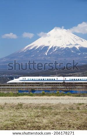TOKYO - March 23: Shinkansen bullet train at Tokyo railway station inMarch 23, 2014 Tokyo, Japan.Shinkansen is world's busiest high-speed railway operated by four Japan Railways companies.  - stock photo
