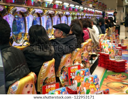 TOKYO - MARCH 29: Unidentified customers play slot machines on March 29,2012 in Tokyo, Japan.Slot machine- the most popular adult gambling in Japan. - stock photo