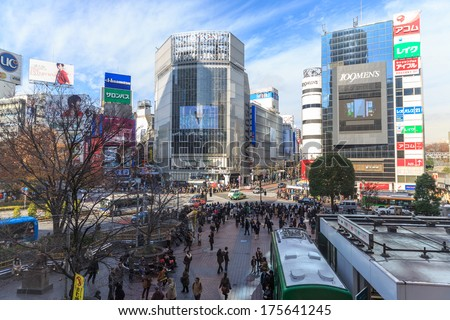 TOKYO - MAY 11: Commuters hurry on May 11, 2012 in Shibuya, Tokyo. Shibuya crossing is one of busiest places in Tokyo and is recognized thanks to being featured in multiple films. - stock photo