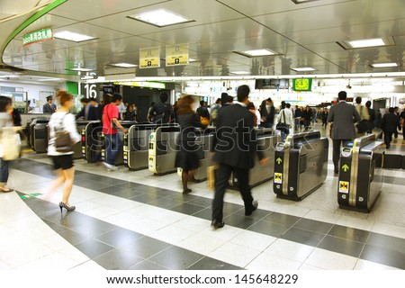 TOKYO - MAY 11: Japanese walking through a ticket gate in Shinjuku station, Tokyo on May 11, 2009. With more than 2 million passengers every day, Shinjuku is the world's busiest railway station.
