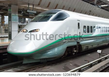 TOKYO - MAY 20: Shinkansen bullet train at Tokyo railway station in May 20, 2012 Tokyo, Japan.Shinkansen is world's busiest high-speed railway operated by four Japan Railways companies. - stock photo