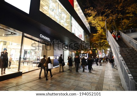 TOKYO - NOV 24: Retail shops on Omotesando Street at night on November 24. 2013, Here you can find famous brand name shops, cafes and restaurants for a more adult clientele.  - stock photo