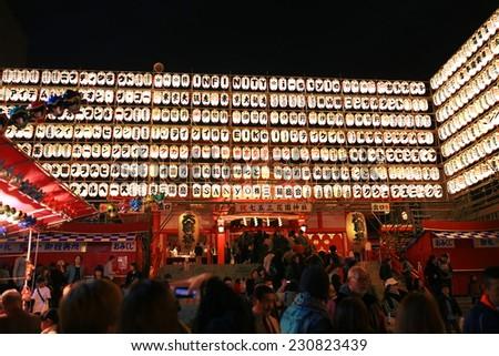 TOKYO - NOVEMBER 9 2014 : Hanazono Jinja Buddhist shrine holds a Engikumade festival, on November 9, 2014 in Tokyo. Engikumade is a traditional Japanese lucky charm bought during festivals. - stock photo