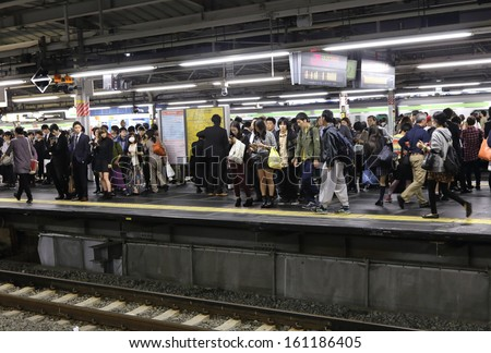 TOKYO -OCT 21 : rush hour at the  Shinjuku train station on 21 October 2013. Shinjuku is one of  the important  district with one of the biggest train station  in Japan. - stock photo