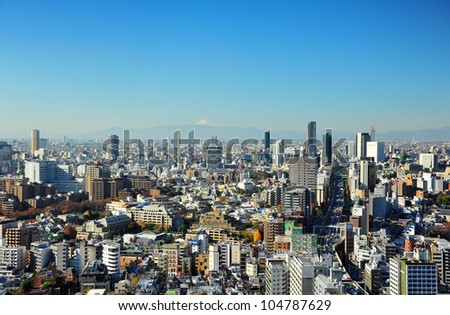 TOKYO - OCT 11: With over 35 million people, Tokyo is the world's most populous metropolis and is described as one of the three command centers for world economy October 11, 2010 in Tokyo, Japan. - stock photo