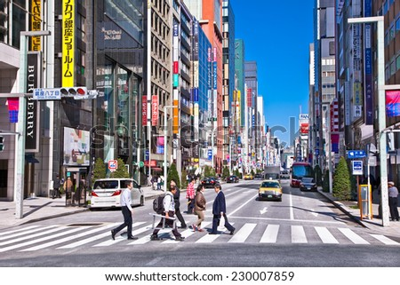 TOKYO - OKTOBER 28, 2014: Ginza shopping district on Oktober 28, 2014 in Tokyo, Japan. Ginza extends for 2.4 km and is one of the world's best known shopping districts. - stock photo