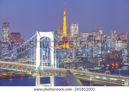 Tokyo rainbow bridge and Tokyo tower at twilight time - stock photo