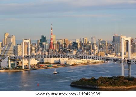 Tokyo Skyline with Rainbow Bridge and Tokyo Tower - stock photo