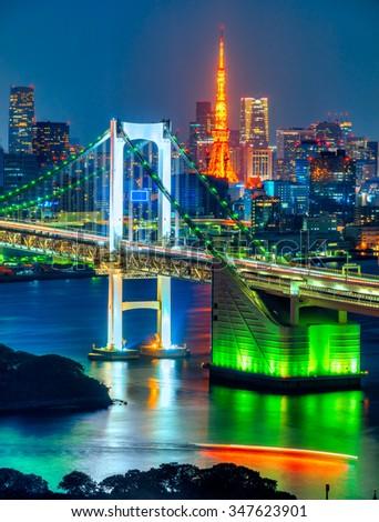 Tokyo skyline with Tokyo tower and rainbow bridge. Tokyo, Japan. - stock photo