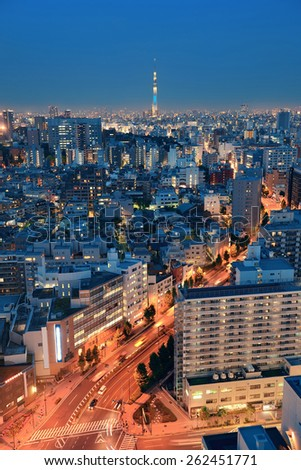 Tokyo Skytree and urban skyline rooftop view at night, Japan. - stock photo