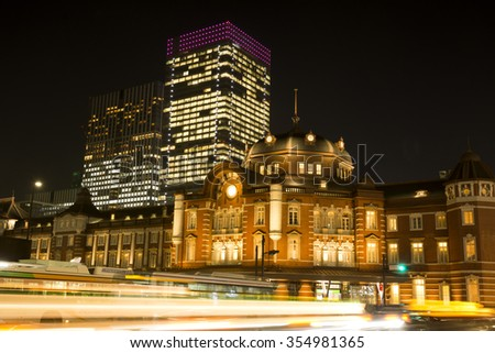 Tokyo station and car light trails at night