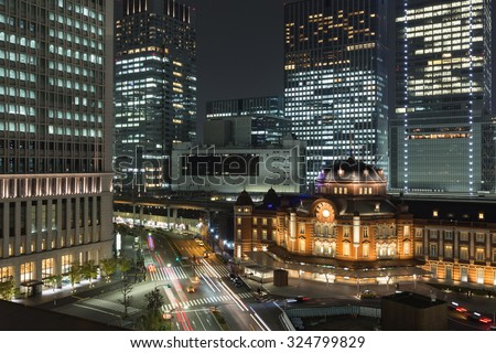 Tokyo station and cityscape with skyscrapers at night  - stock photo