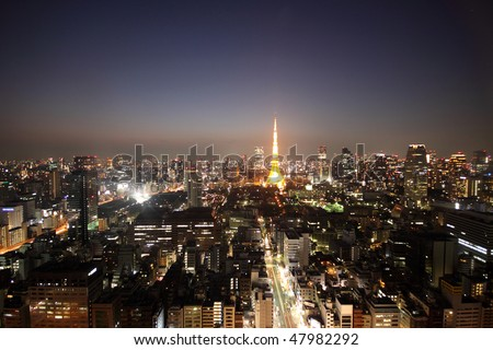 Tokyo Tower among the night skyline of Tokyo, Japan during sunset