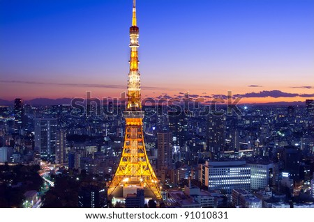 Tokyo Tower as the sun sets in the horizon - stock photo