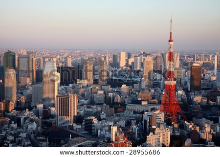Tokyo Tower with skyline as seen from Mori Tower - stock photo