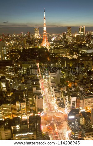 Tokyo Tower with the view of buildings in Tokyo at twilight time