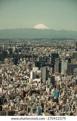 Tokyo urban skyline rooftop view with Mt Fuji, Japan. - stock photo