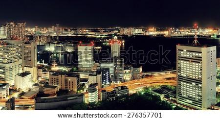 Tokyo urban skyscraper skyline rooftop view at night, Japan. - stock photo