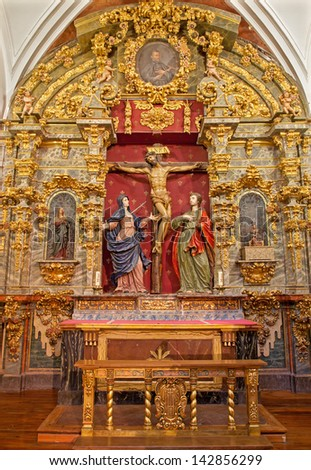 TOLEDO - MARCH 8: Crucifixion baroque statue with hl. Mary and saint John from church Iglesia de san Idefonso on March 8, 2013 in Toledo, Spain. - stock photo