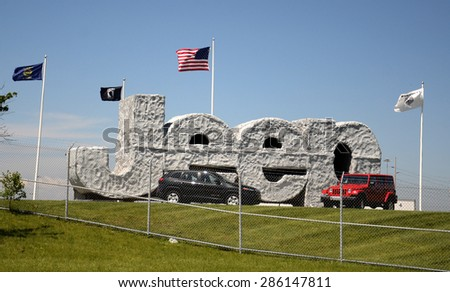 TOLEDO, OH - JUNE 2:  Fiat Chrysler will determine soon whether to keep building Jeeps at the Toledo Chrysler Assembly Plant, whose Jeep sign is shown on June 2, 2015.  - stock photo
