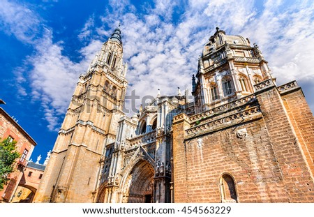Toledo, Spain. Primate Catedral in ancient city on a hill over the Tagus River, Castilla la Mancha medieval attraction of Espana. - stock photo