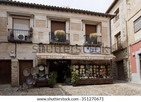 TOLEDO, SPAIN - SEPTEMBER 5 2015: Shop selling traditional ceramic handicrafts from Castilla-La Mancha, on September 5, 2015, in Toledo, Spain - stock photo