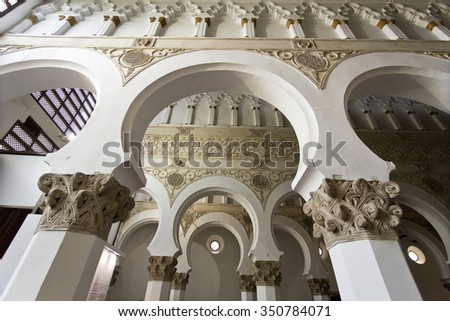 TOLEDO, SPAIN - SEPTEMBER 5 2015: Synagogue of Santa Maria la Blanca built in 1180 under the Christian Kingdom of Castile by Islamic architects for Jewish use.on September 5, 2015, in Toledo, Spain - stock photo
