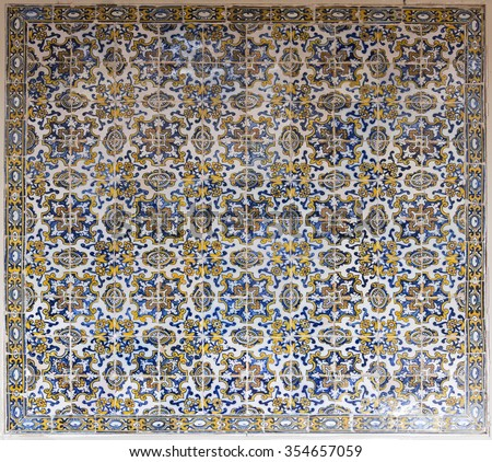 TOLEDO, SPAIN - SEPTEMBER 6 2015: 17th century polychrome Panel of Portuguese Tiles in the Museum of Santa Cruz, on September 6, 2015, in Toledo, Spain - stock photo