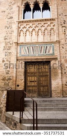 TOLEDO, SPAIN - SEPTEMBER 5 2015: The mudejar facade of the ancient University, on September 5, 2015, in Toledo, Spain - stock photo