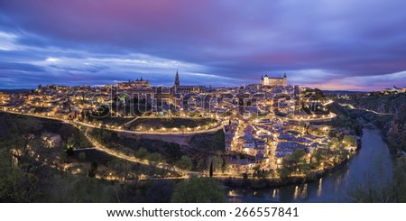 Toledo, Spain town skyline on the Tagus River at night - stock photo