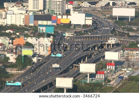 Toll booths on a busy highway in the middle of downtown Bangkok - stock photo