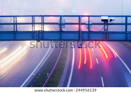 toll gate, City expressway road in the morning fog, Lochkov tunnel, Prague, Czech republic - stock photo