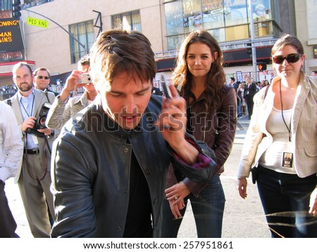 "Tom Cruise and Katie Holmes at the ""War of the Worlds"" Los Angeles Fan Screening held at the Grauman's Chinese Theater in Hollywood on June 27 2005. - stock photo"