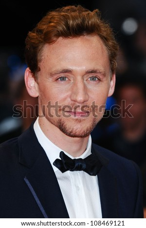 "Tom Hiddlestone arrives for the ""Avengers Assemble"" premiere at the Vue cinema Westfield, London. 19/04/2012 Picture by: Steve Vas / Featureflash"