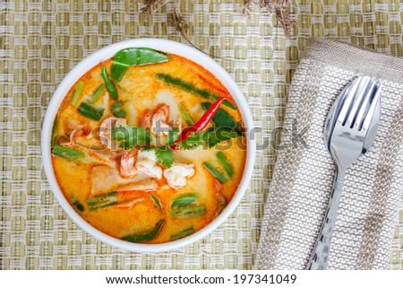 Tom yam kung or Tom yum, Tom yam is a spicy clear soup typical in Thailand and No.1 Thai Dish Cuisine. - stock photo